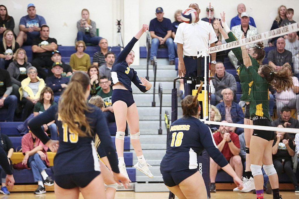 Nevada Union's Faith Menary hits one over the net for the Lady Miners.