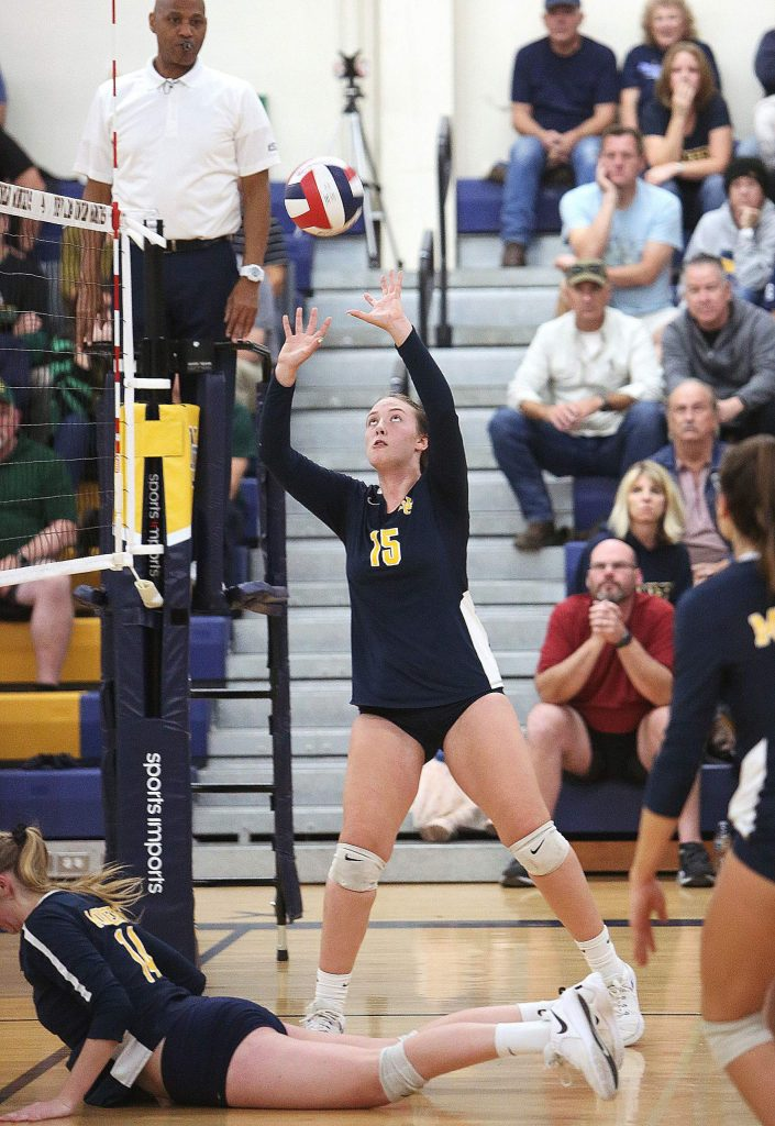 Kendall Hughes (15) sets the ball for her team mates during Tuesday's win over the Yellowjackets.