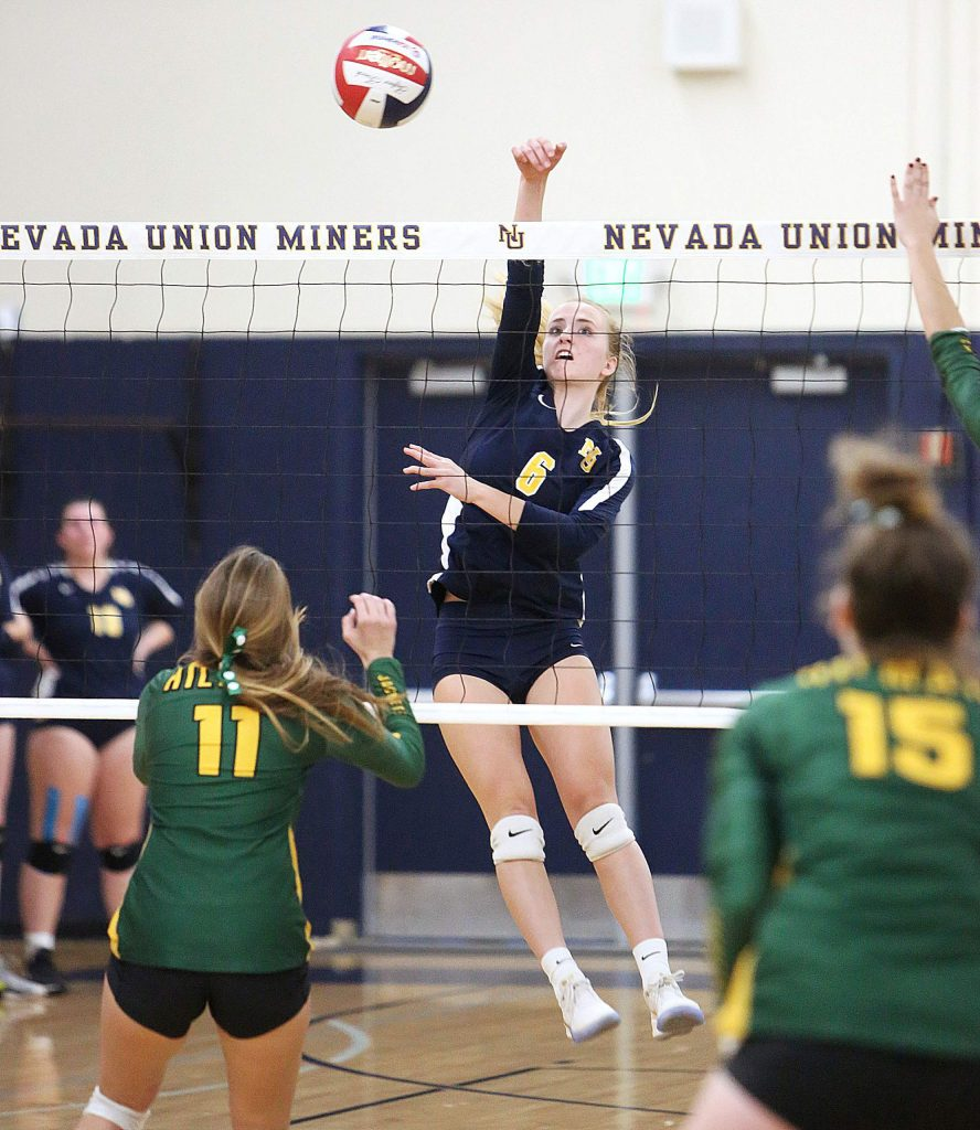 Nevada Union sophomore Kayda Kinch (6) puts one over the net for the Miners.