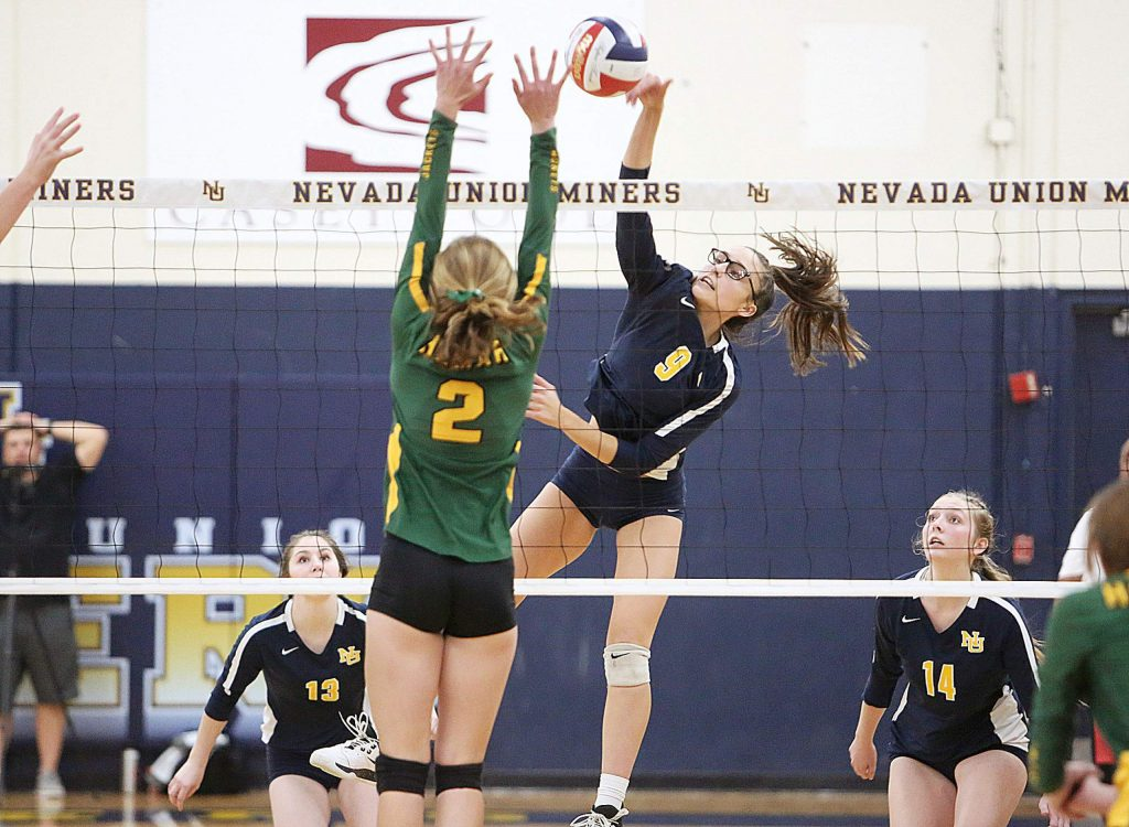 "Nevada Union 5'11"" junior Kailee McLaughlin (9) spikes a ball over the net for the Miners during their 5 set win over last year's state champs, the Hilmar Yellowjackets."
