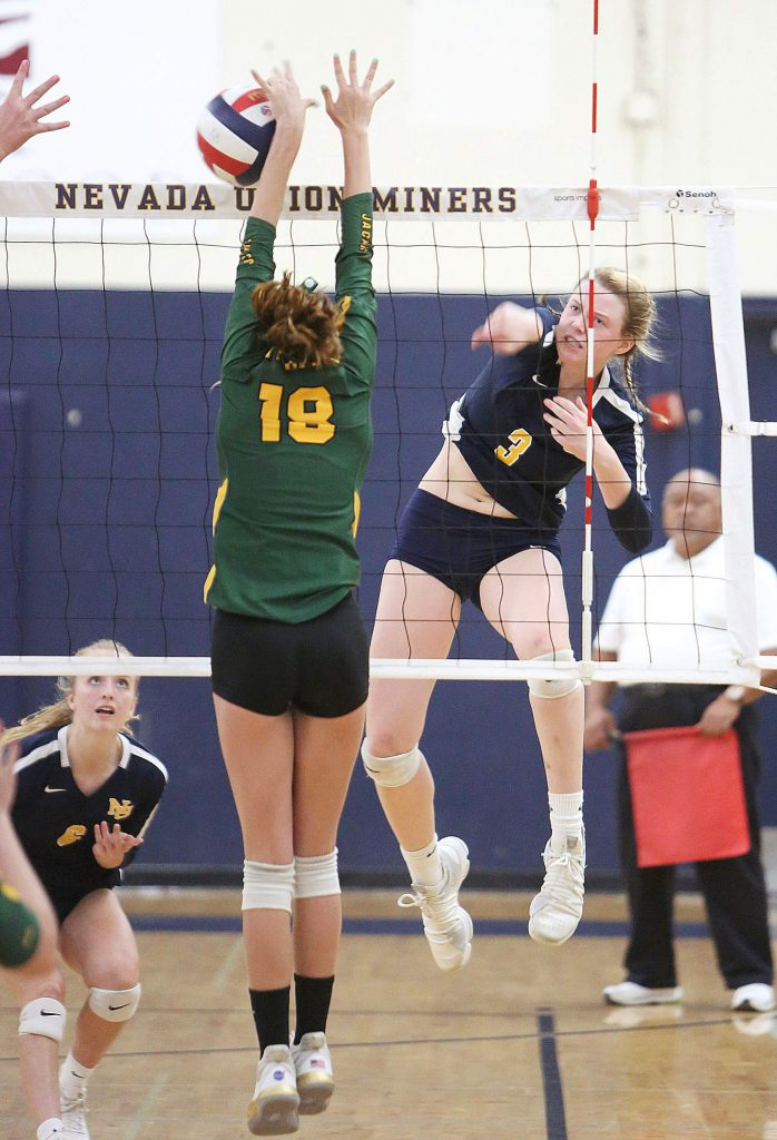 Nevada Union senior Faith Menary (3) spikes the ball during the Miners' win over the Yellowjackets.