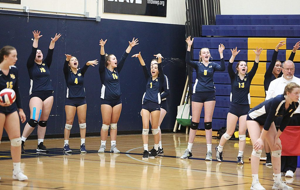 The Miners sideline erupts into a state of jubilation following the winning of a point during the Miners match against Hilmar.