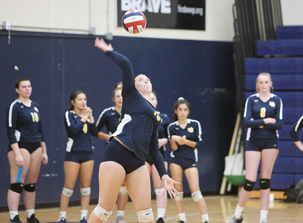 Ashlyn Franssen serves the ball for the Miners.