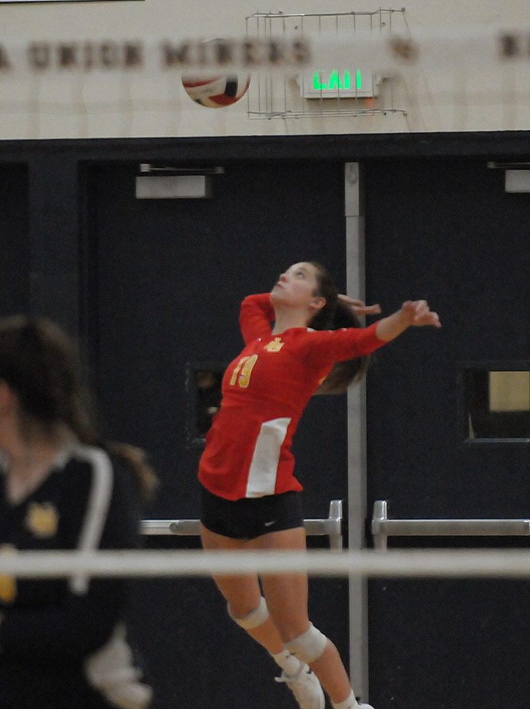 Nevada Union's Kendall Gould serves during the Lady Miners' Sac-Joaquin Section playoff win over Kimball Thursday night