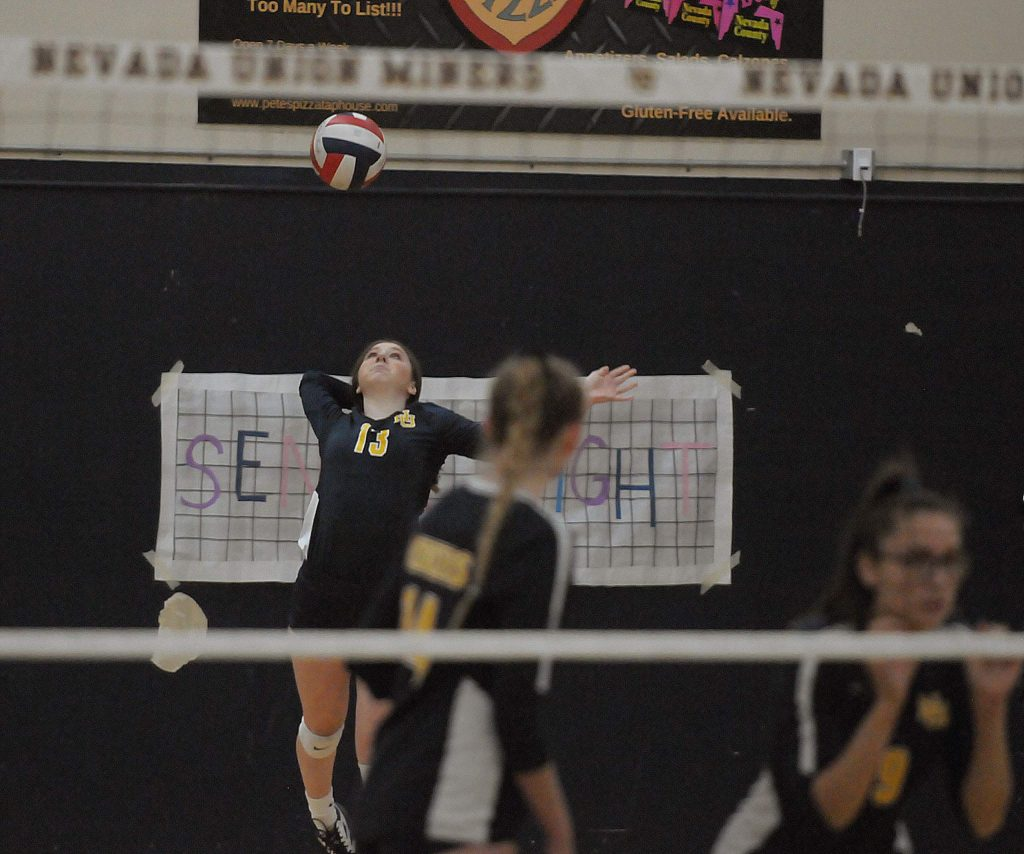 Nevada Union's Reese Werner serves during the Lady Miners' Sac-Joaquin Section playoff win over Kimball Thursday night.