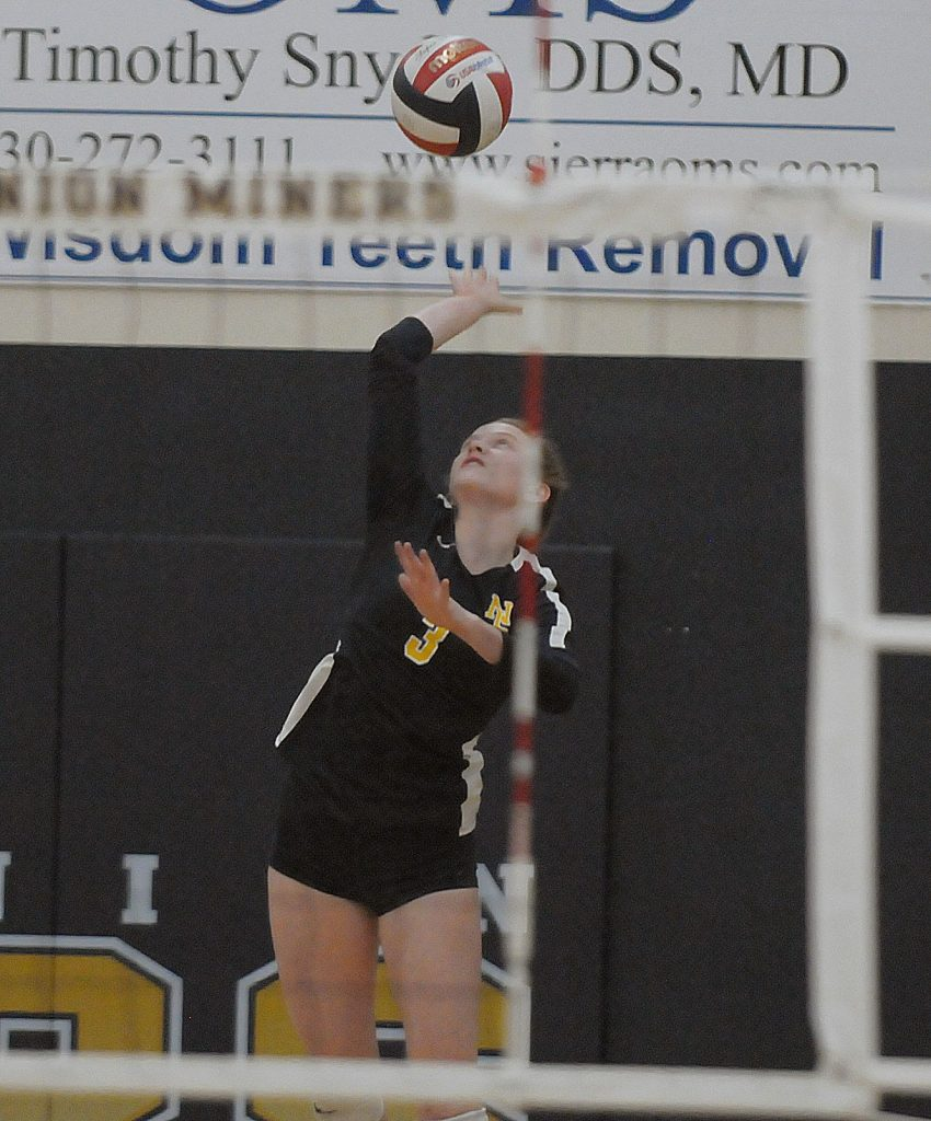 Nevada Union's Faith Menary serves during the Lady Miners' Sac-Joaquin Section playoff win over Kimball Thursday night