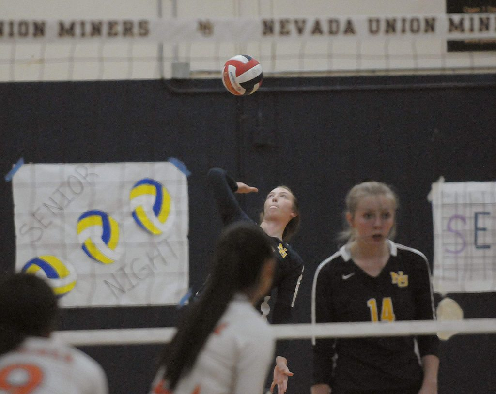Nevada Union's Kendall Hughes serves during the Lady Miners' Sac-Joaquin Section playoff win over Kimball Thursday night