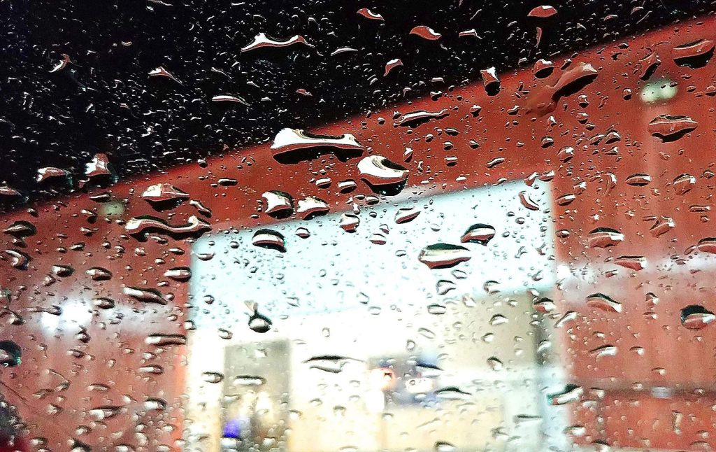 Drops of rain gather on the windshield of a vehicle in the Glenbrook Basin Tuesday evening.