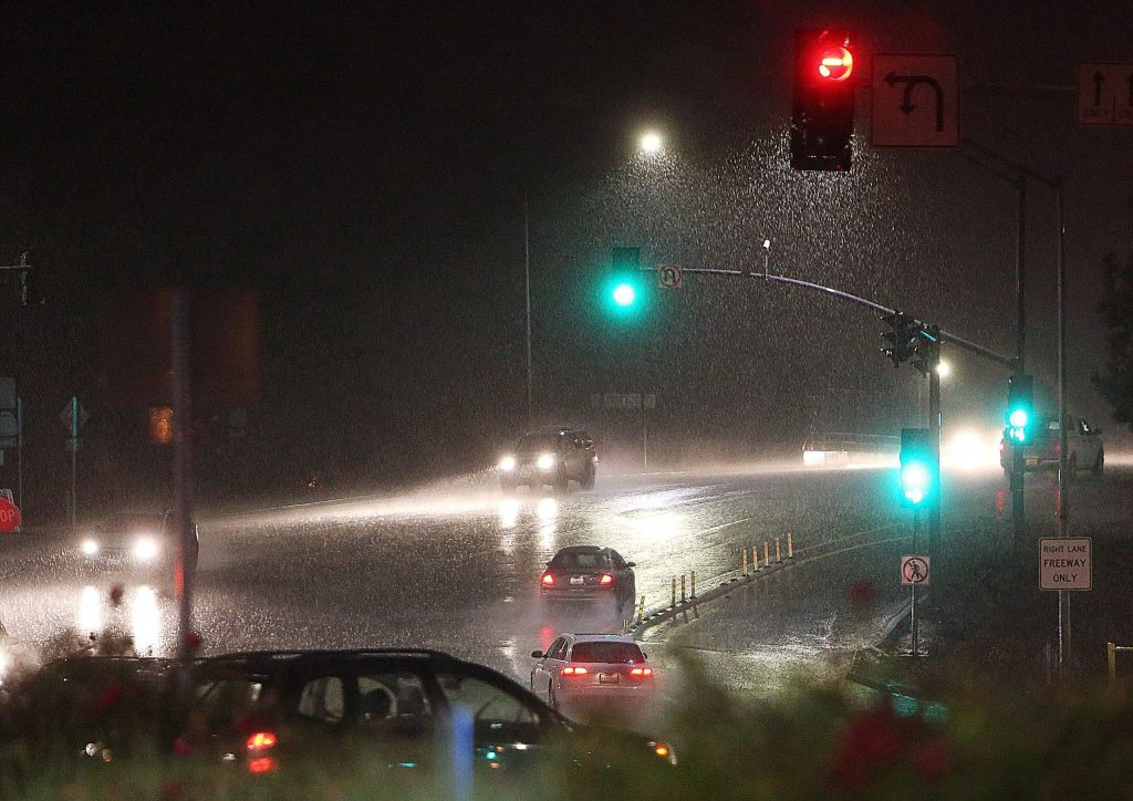 Rain pours over the Brunswick overpass during Tuesday evening's rain storm.