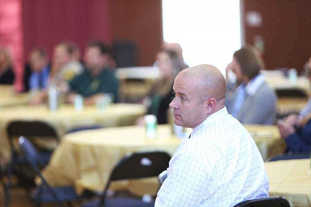 David West listens to the other speakers present during last Thursday's PaYS program partnership ceremony.