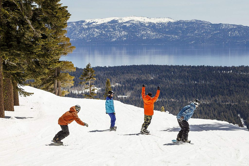 Snowboarding at Alpine Meadows with views of lake tahoe