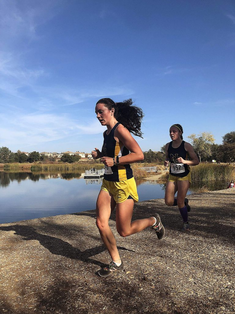 Nevada Union's Megan Schreck, left, and teammate Sephora Wontor, compete in the Sac-Joaquin Section Division 3 championship Nov. 16. As a team the Lady Miners finished second overall to earn their place at Saturday's State Championships in Fresno.