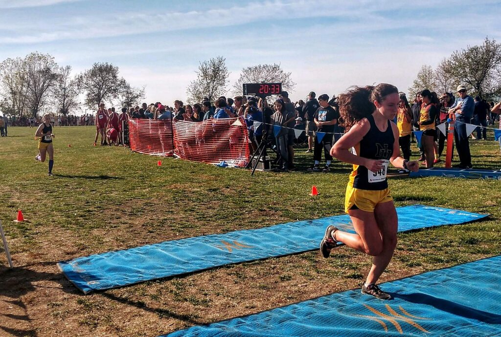 Nevada Union's Megan Schreck, right, finishes in sixth place, just ahead of teammate Sephora Wontor, left, in the Sac-Joaquin Section Division 3 championship race held Saturday at Willow Hill in Folsom.