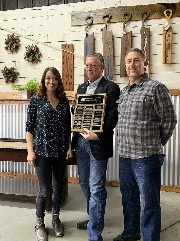 From left, Michelle Layshot, Millennium Planning and Engineering; Rich Peevers, president of the Engineer's Association of Nevada County; and Robert Wood, Millennium Planning and Engineering. Millennium Planning and Engineering received the 2019 Project of the Year Award.