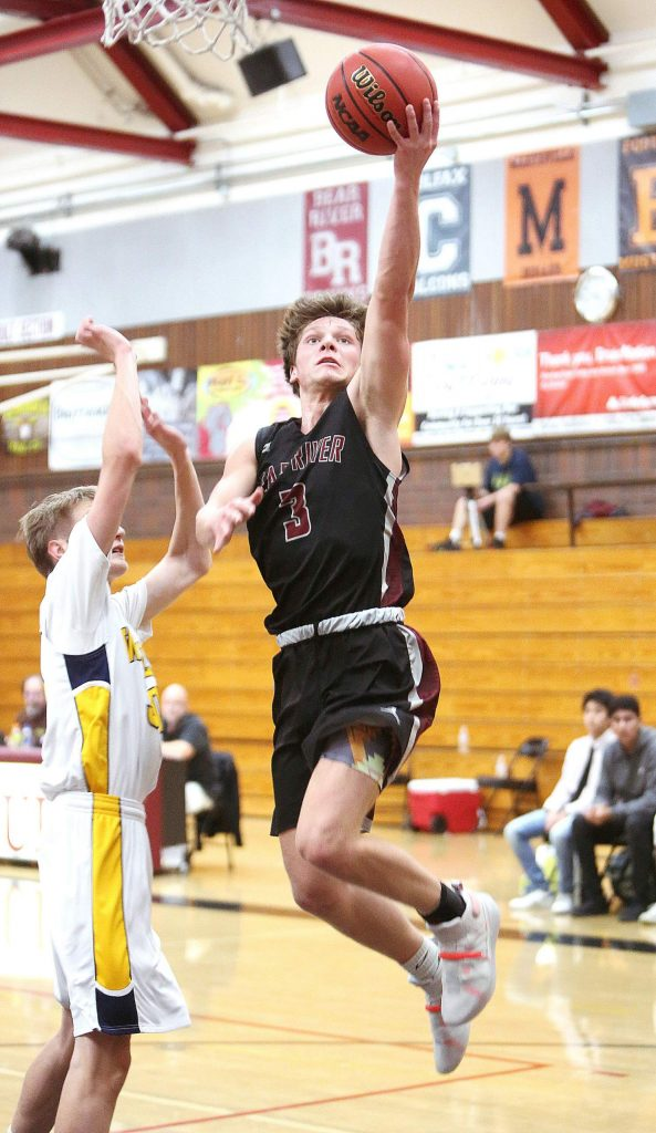 Bear River's Brekyn Vasquez (3) attacks the hoop for two of his 11 points during Thursday's 58 - 55 win over the Western Sierra Wolves in the first round of the Ganskie Invitational.