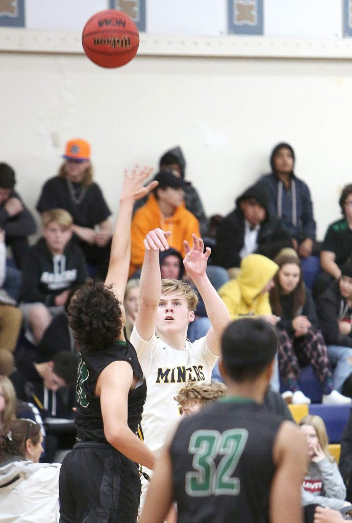 Nevada Union's Charles Wilcoxen hits one of his four 3-pointers during a game against River Valley in the first round of the Justin Gardner Memorial Tournament, Thursday at Albert Ali Gymnasium.
