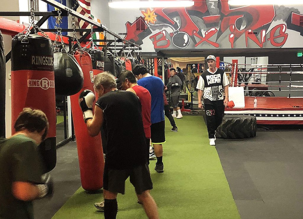 Brian Scott, right, runs a class at T-5 Boxing in Grass Valley. Since T-5 Boxing opened its doors 18 months ago, the gym steadily built a large base of students and has since had to expand its facility.