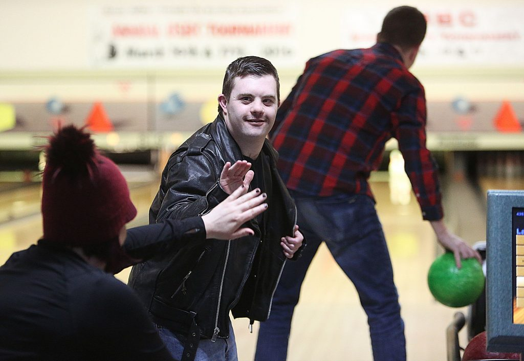 31) Grass Valley resident Skyler Tonti gets a high five from his teammates during the 37th annual Bowl For Kids Sake held at Prosperity Lanes every March.
