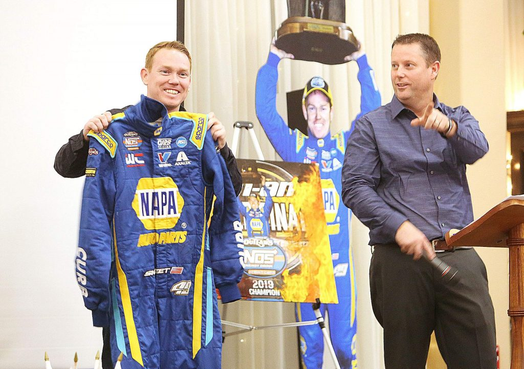 FILE — Brad Sweet, a Bear River graduate, auctioned off one of his racing suits from the 2019 season to benefit the Bear River FFA during a tri-tip dinner in 2019. The dinner was prepared by the Bear River FFA as well. On the right is fellow Bear River grad and voice of the Silver Dollar Raceway Troy Hennig.