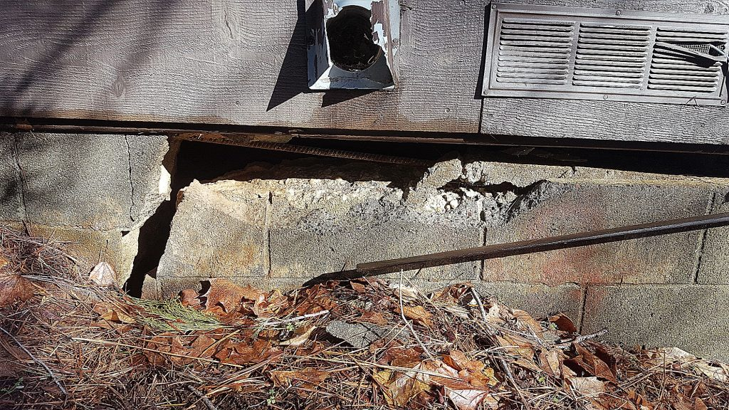 A large crack runs through the foundation of a home on Pasquale Road damaged by a 2017 landslide. The former owners of the residence are suing Nevada County.