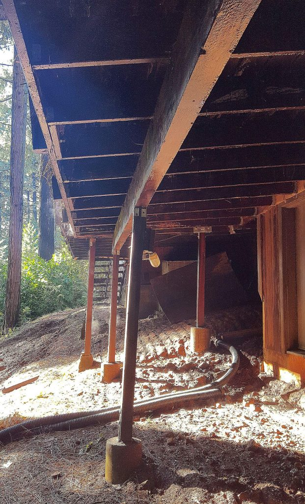 Buckling can be seen underneath the deck of a home on Pasquale Road damaged by a 2017 landslide. The former owners of the residence are suing Nevada County.