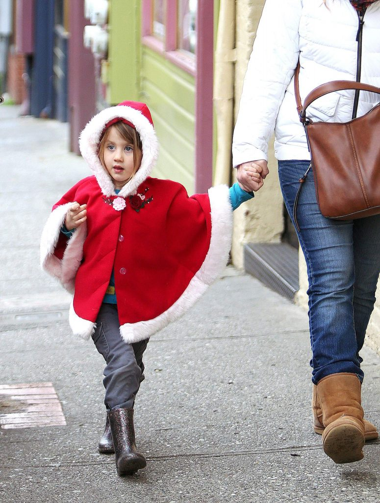 Four-year-old Harper Scharetg takes in the sights and sounds of Commercial Street in downtown Nevada City while walking with her mother Michelle on Christmas Eve.