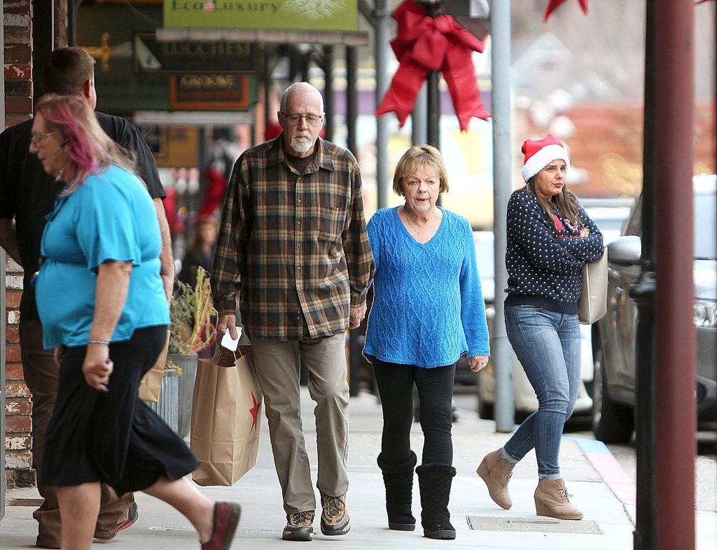 The sidewalks off of Mill Street in downtown Grass Valley were full of pedestrians getting their last minute Christmas shopping in.