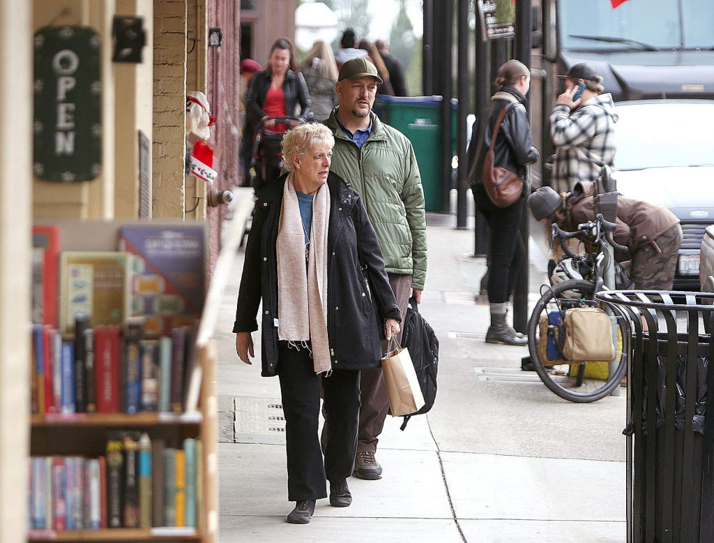 Folks in Nevada City get some Christmas Eve shopping in Tuesday.
