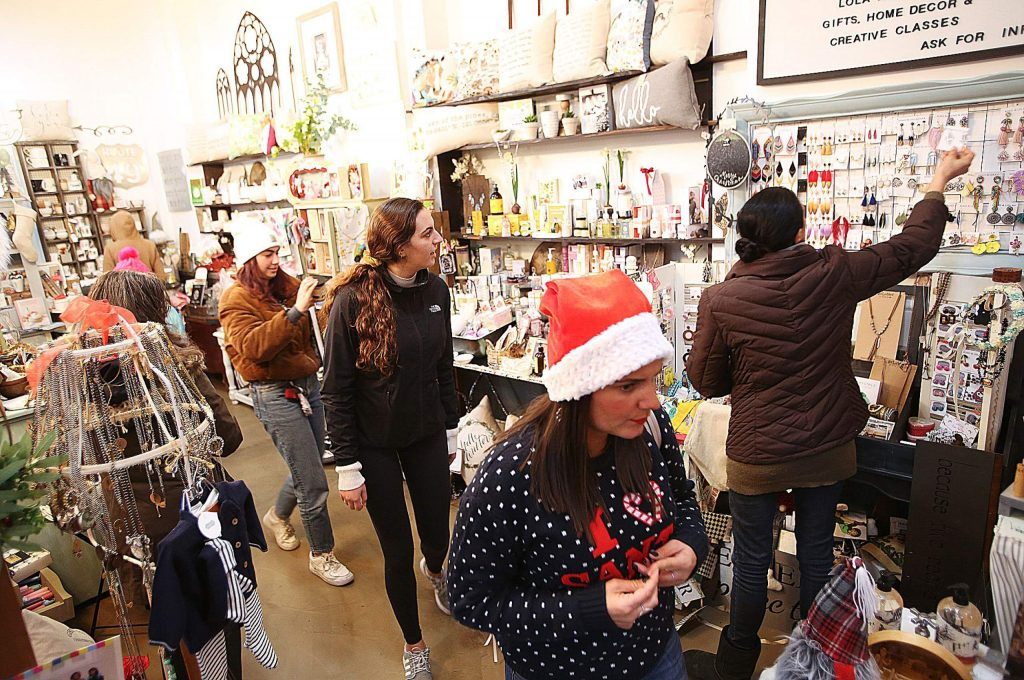 Shoppers peruse through the items at Lola and Jack's Gifts, Home Decor & Creative Classes inside of the old Nevada County Bank Building.