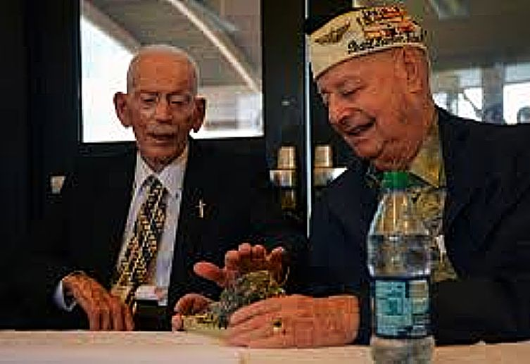 Battleship USS Arizona survivors John D. Anderson, left, and Louis A. Conter examine a 3-dimensional model of a cooking pot that sits on the Arizona during a press conference Dec. 2, 2014.