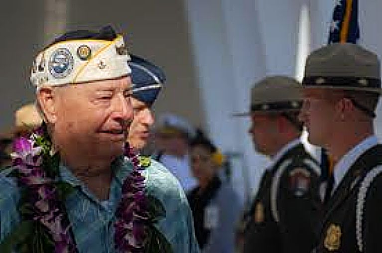 With tears in his eyes, Louis Conter, a survivor of the Japanese attacks on the USS Arizona, Dec. 7, 1941, thanks the National Park Service honor guard after a ceremony on the USS Arizona Memorial Dec. 7, 2010. (U.S. Air Force photo by Staff Sgt. Carolyn Viss)