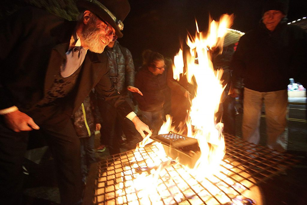 Cecil Snow keeps Cornish Christmas goers warm and toasty on Mill Street during the first of the annual Grass Valley arts and crafts street faire which kicked off its winter run Friday.