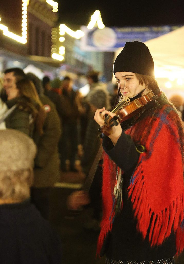Athena Giuliani plays her violin on Mill Street during Friday's Cornish Christmas.