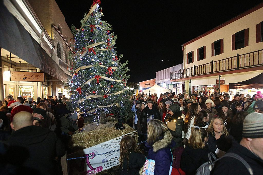 The Downtown Grass Valley Association's downtown tree lighting ceremony took place on Mill Street this year where the city's tree will remain throughout the holiday season.