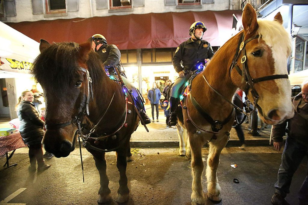 The CHP's mounted units were in festive attire as they stood along Mill Street during Friday's first Cornish Christmas of the holiday season.