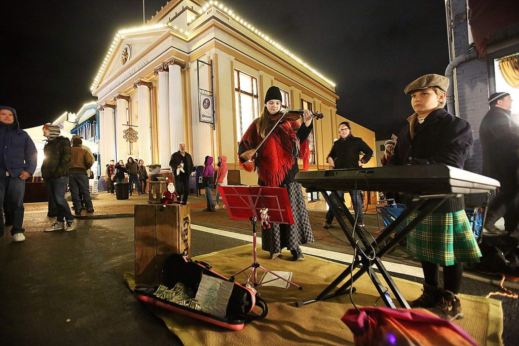 Athena Giuliani and her brother Leander play from a selection of festive tunes on their violin and keyboard during Friday's Cornish Christmas.