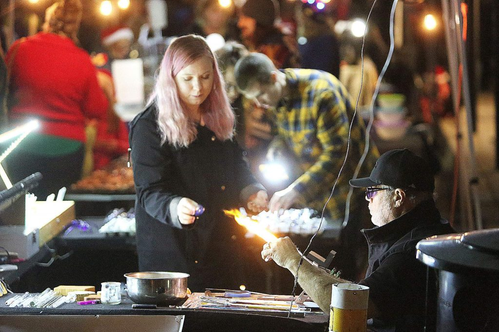 Seventeen year Cornish Christmas vendor, Jeff Petty of Gold Bug Glassblowers, says he enjoys making his products in front of attendees of the event.