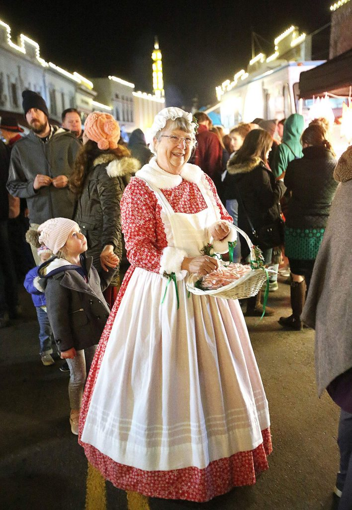 """Thousands of people packed the streets of downtown Grass Valley Friday for the final Cornish Christmas of the decade where folks could buy wares from vendors and run into the likes of Karen Arbaugh who said, """"happy Christmas"""" to attendees while handing out candy canes."""