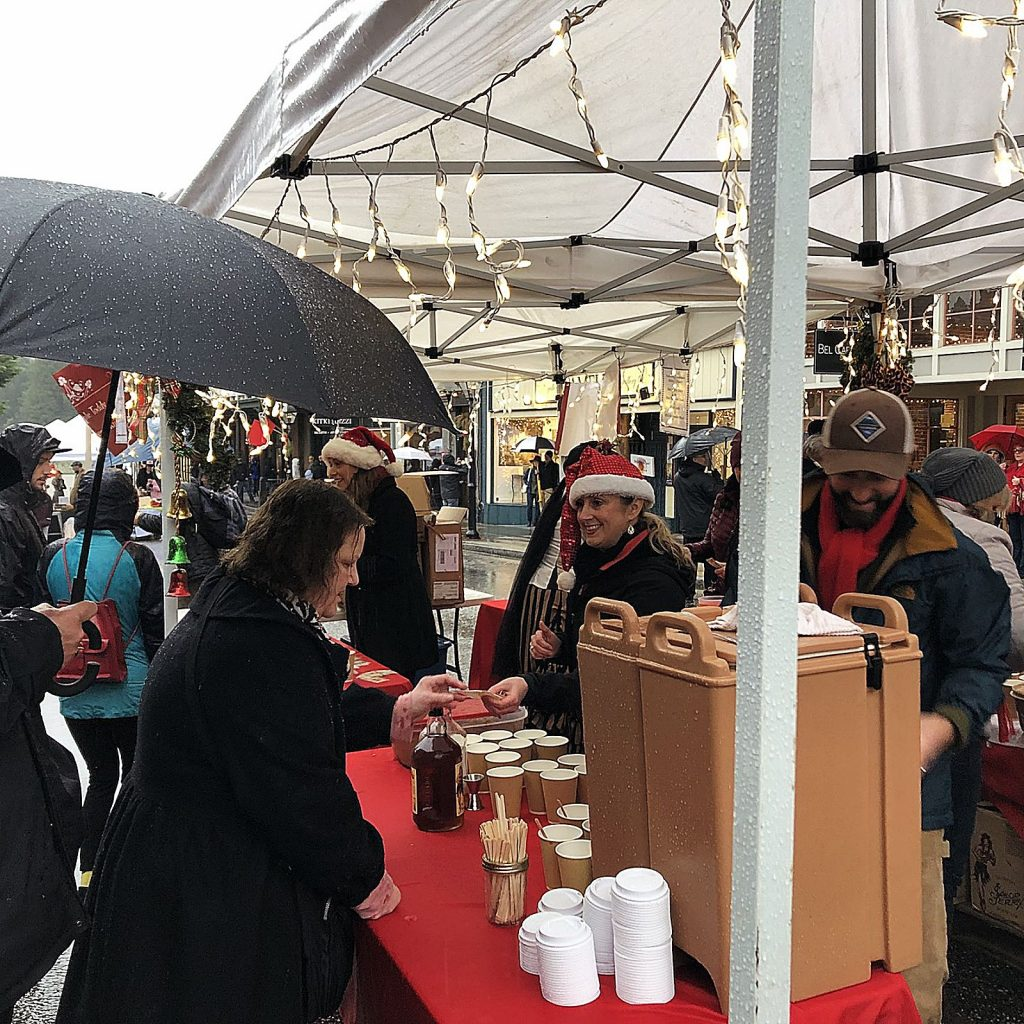 Volunteers with the Nevada City Chamber of Commerce pass out a variety of drinks at Nevada City's Victorian Christmas.
