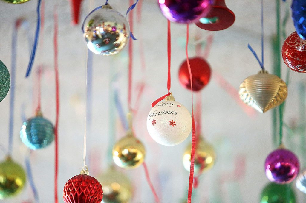 Many different types of Christmas tree ornaments are on display hanging from the ceiling at Margarita's, but most are the traditional bulb style.