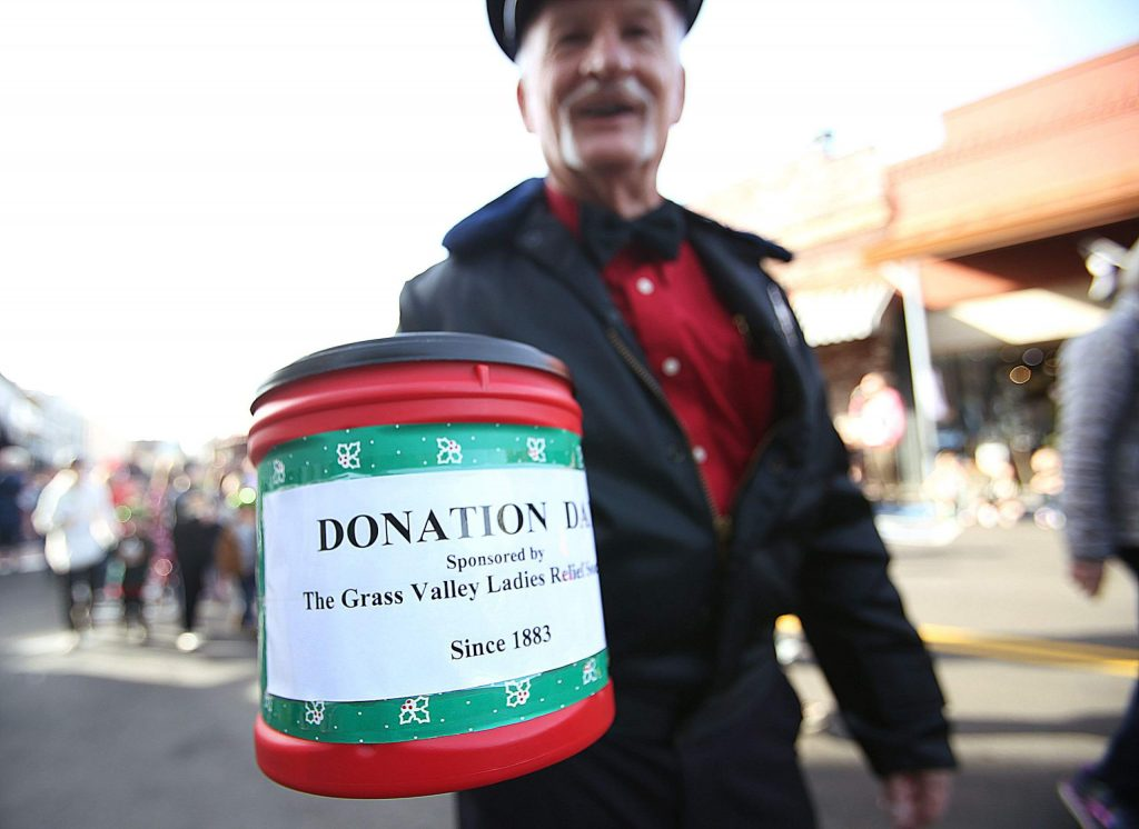 Charlie Jakobs walks the Donation Day parade route collecting monetary donations for the Ladies Relief Society.