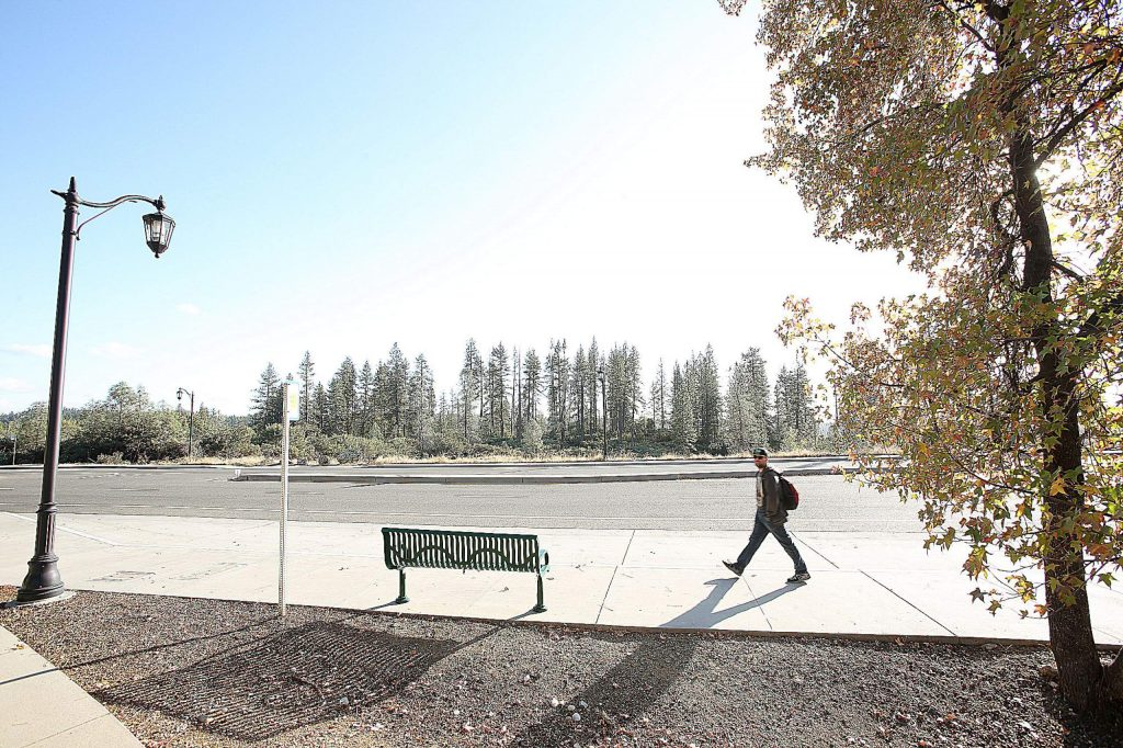 A pedestrian walks along Dorsey Drive across from where the proposed 28 acre Dorsey Project would be built including commercial anchor tenants and apartment complexes.