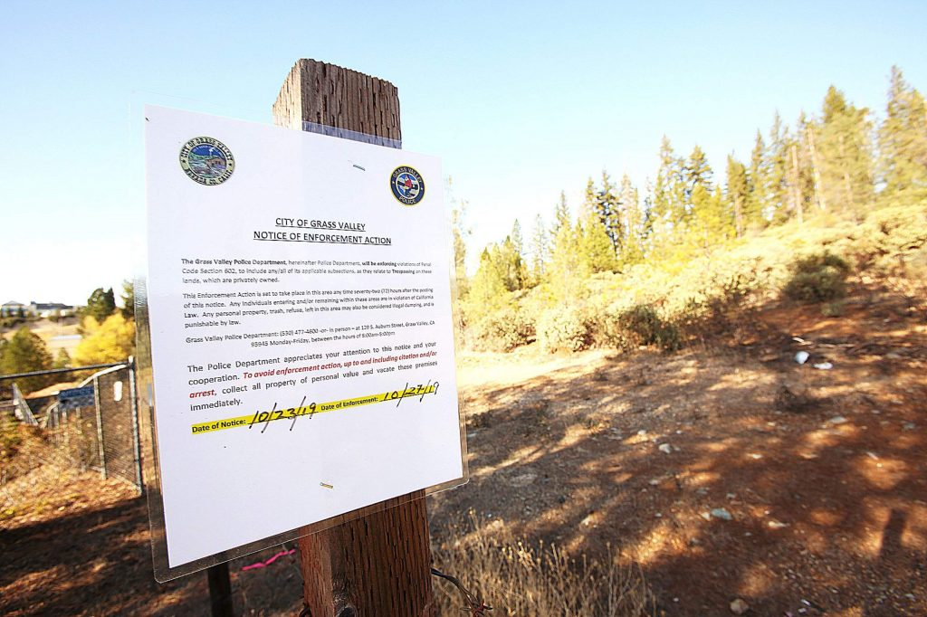 City of Grass Valley enforcement action notices are posted on the site of the Dorsey Project where transient encampments have historically resided.