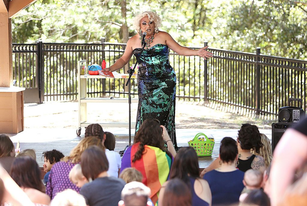 23) Drag queen Miss Taryn referred to herself as a clown that likes to dress up before reading a pair of Dr. Seuss books to the children and their parents in June at the Madelyn Helling Library in Nevada City. A crowd of protesters and anti protesters had gathered in front of the building.