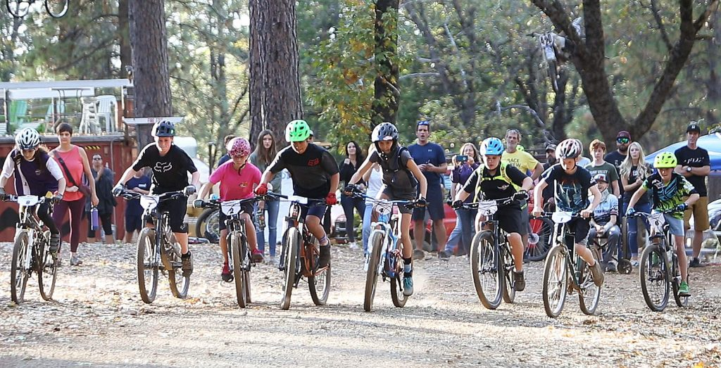 The advanced group of mountain bike racers take off at the sound of the start on Osborne Hill Road in Grass Valley where the first ever Union Hill Invitational Mountain Bike Race took place.
