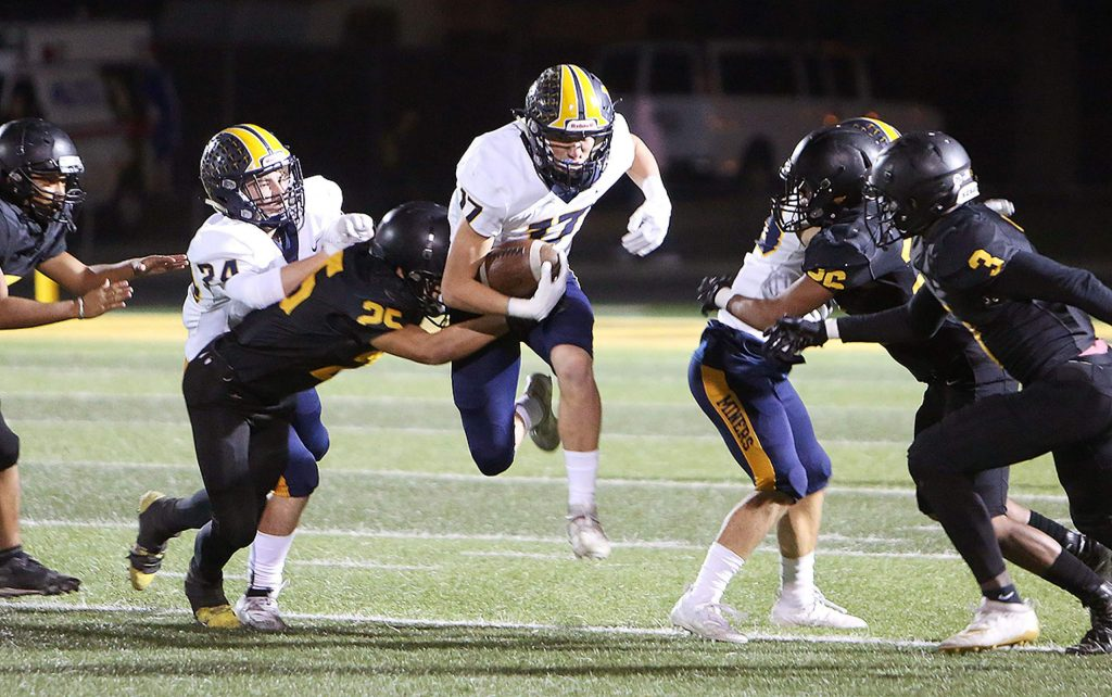 Nevada Union's Ben Taylor runs the ball for the Miners.