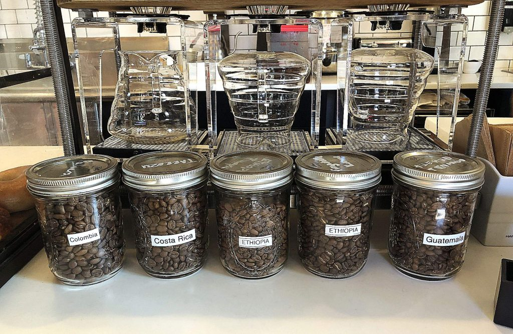 Jars of beans display the types of fair trade coffee available at Fable Coffee in Grass Valley.
