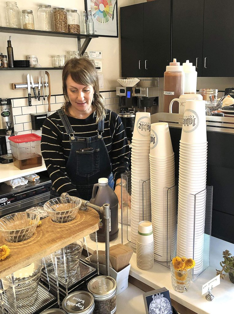 Owner Amanda Daley prepares a latte at Fable Coffee, located on the corner of Mill and Neal streets in Grass Valley.