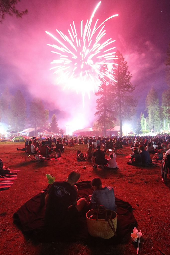 7) The lights of exploding fireworks illuminate the hundreds of families that took to the open fields of the Nevada County Fairgrounds to enjoy the Hats off to Nevada County Fourth of July fireworks show on Independence Day.