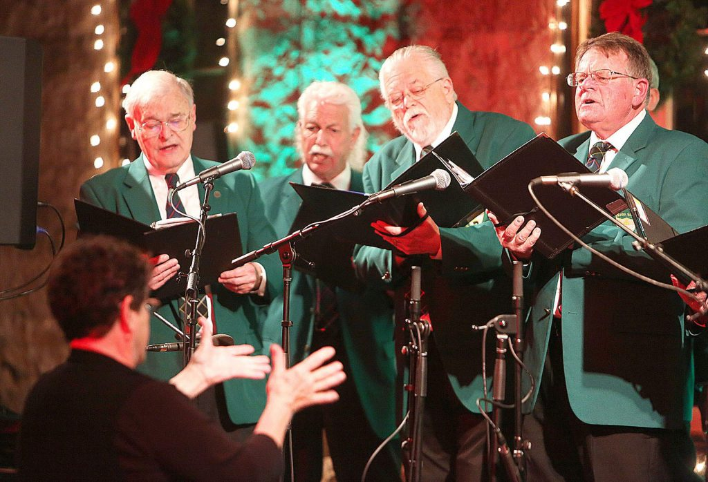 The Grass Valley Men's Chorus, led by Eleanor Kenitzer, was one of more than 30 performers or acts to play at the Miners Foundry during Saturday's Night of Giving to benefit the Hospitality House.
